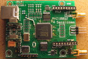All-in-one PCB, containing USB interface, FPGA, A/D's, amps, and filters.